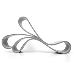The curves of the Ribbon Chair by Vivianne Kollevris have the strength of concrete with thin and elegant form.