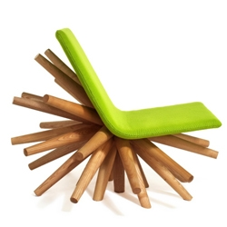 """This very unique and funky UK chair is hand crafted with American Ash. The seat is filled with high-density polyethylene foam and the upholstery colors are optional."