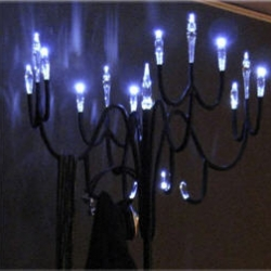 """The """"Antigravity Chandelier"""" an exquisite object from japanese designer Jun Tase.  Is a lamp and a coat hanger at the same time."""