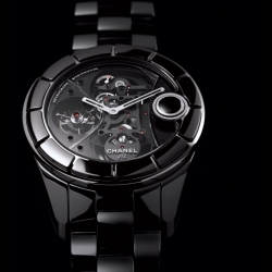 The new J12 Rétrograde Mystérieuse watch by Chanel includes a vertical retractable crown to ensure optimum comfort on the wrist. A concentrated dose of innovation designed by the Giulio Papi team.