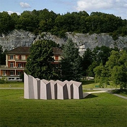 Localarchitecture and Danilo Mondada designed this temporary chapel in Switzerland. Folded planes on the walls give the building structure, while generating acoustic refractors on the inside.