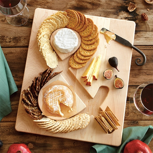 Uncommon Goods Cheese & Crackers Board - Made of solid maple. Nice detail of milled out grooves that make your crackers lean perfectly.