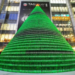 A giant Christmas tree was made with 1000 heineken beer bottles. Seen in front of the Nanjing road mall in Shanghai.