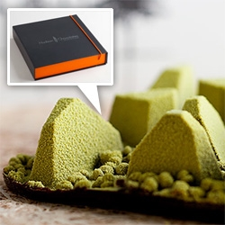 """Hudson Valley Mountain Range by Hudson Chocolates - Anchored on a ground of darkchocolate blended with crispy puffed rice, each chocolate """"mountain"""" is filled with a different flavor."""