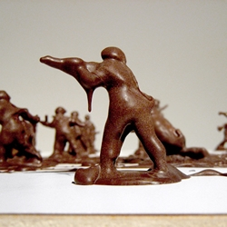 "The installation ""Battle of Losers and Lovers"" by Stephen J Shanabrook in which Shanabrook common plastic toy soldiers are covered in actual dark chocolate."