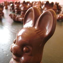 Photographs from the self-titled exhibit by Momoyo Torimitsu, featuring dozens of cast resin sculptures imitating melting chocolate Easter bunnies.