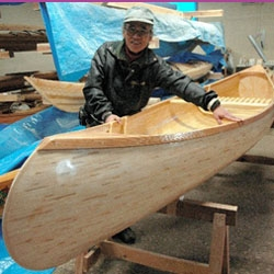 "This man spent 3 months gluing 7382 used chopsticks into a 66 pound, 13'-4"" canoe.  It's beautiful."