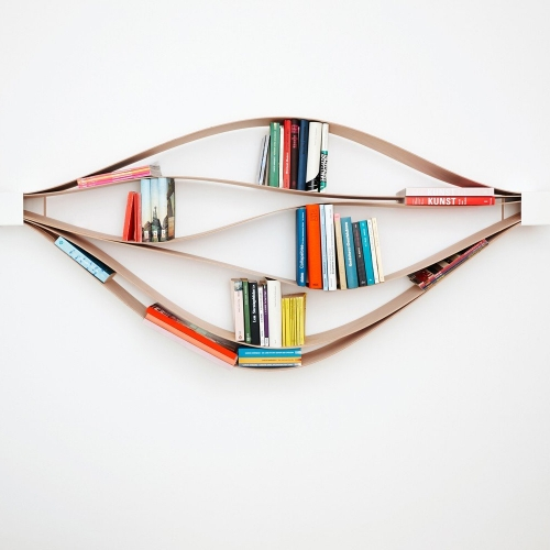 Chuck by NEUVONFRISCH - Form follows content.  It's a highly flexible object that changes with your inclination. Your contents and your placement of them, determine the form. The six thin and sturdy plywood boards flex to accommodate objects.