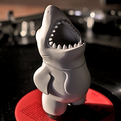 Chums - Terror of the Deep, is a vinyl toy specifically designed to hold various cylindrical objects (tablet pens, pencils, flashlights, cigars) in his mouth!