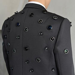 Aposematic Jacket by Shinseungback Kimyonghun is a wearable computer for self-defense. When the wearer pushes a button under threat, the jacket records the scene in 360 degrees and sends the images to the Web.