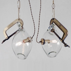 Clamp Pendants by Lindsey Adelman ~ each lamp is hand blown and thus unique in shape!