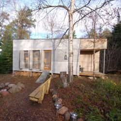 "Bryan Meyer and Anne Ryans's 220sf off-grid Clara Cabin located in Northern Minnesota is described as ""a glorified tent - a primitive room in the woods""..."
