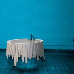 Clinker tables by Rich Brilliant Willing, produced by Innermost, are created from wood slats resembling clapboards, overlapping each other, random lengths create the haphazard form of the tables. Formerly titled: Matryoshka.
