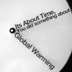 A clock using the hands as a call to action for the sake of the environment. Two clear discs, with type printed on, rotating to communicate the message and the time.