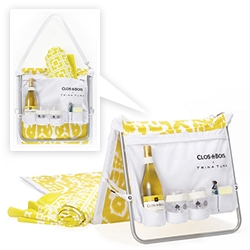 The Clos On The Go by Trina Turk for Clos du Bois. Tote bag converts to a seat with waterproof pockets custom-designed to hold a bottle of wine, a corkscrew, two GoVino reusable wine glasses, playing cards and beach towel.