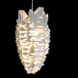 loosely resembling a pixellated mythical cloud city, Phil Cuttance's new pendant lamp shade was inspired by simple paper folding techniques used in pop-up books.