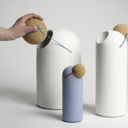 Series of objects inspired by the red clown nose by Thomas Kral. The cork cover is connected to the ceramics container with coloured elastic.