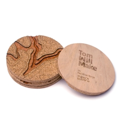 The Topo Coaster is a simple cork coaster with big intentions: to inspire people to seek out the real topography it displays. The geographic coordinates for that place are engraved on the back.