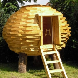 The Coco-Hut is a whimsical structure made of recycled and FSC-certified wood. Looks cozy!