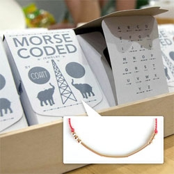 COATT Morse Code Jewelry has beautiful packaging, and is displayed on Wasara disposable paperware... (Thats the SOS message!)