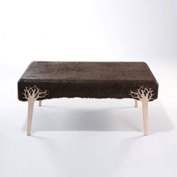 Israeli designer Yoav Avinoam has developed a handcrafted method for casting unique furniture from repurposed sawdust.