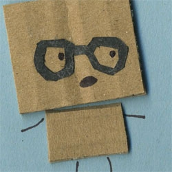 Cute new episode of My Cardboard Life. Cardboard Colin tries out a geeky new look.