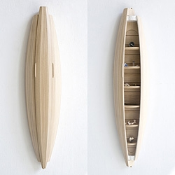 Collectors Cabinet for curios made with masterful coopering techniques from American Ash by Jeremy Zietz. Its hull shape evokes that of travel and adventure, or appears as a bio-mimi pod of precious findings.