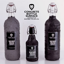 Beer bottles covered with a special concrete based surface by Remember The Lion.