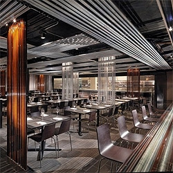 An existing array of conduit electrical tubes inspired Stanley Saitowitz on the interior design for Conduit, a stylish restaurant in San Francisco. The lines generated with the tubes help enclose the space without requiring walls.