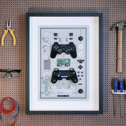 "Framed Tech - they disassemble and arrange everything from Atari 2600 to PS3 Controllers to iPhone 3GS to Kindles and more. ""If you can't open it, you can't own it."""