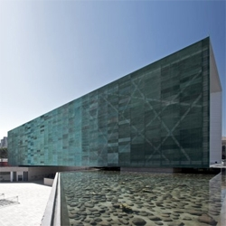 Brazilian practice Estudio America recently completed an astonishing museum in Chile, with a perforated copper skin that adds an interesting texture to the big cantilevering box.