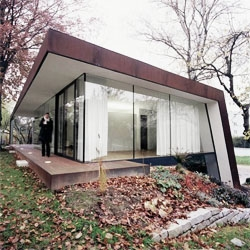 X Architekten designed this house extension using a corten skin, which blends with the surrounding garden during time.