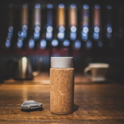 Coffee mug for the coffee connoisseur. CORTIÇA is a 12 oz porcelain travel mug wrapped and insulated with cork, sustainable, eco friendly.