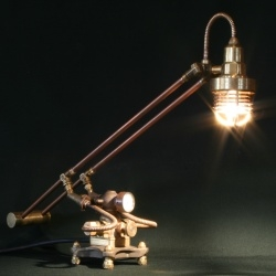 Cory Barkman creates lamps entirely from scrap and gives them an old-world look. A blend of the old and the new, each lamp is unique with functional valves, gauges and clocks.