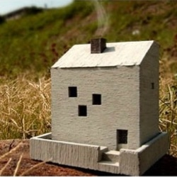 Watch the scented smoke coming out from the chimney of this lovely incense pot made with cement. Another great design by Nobuhiro Sato.