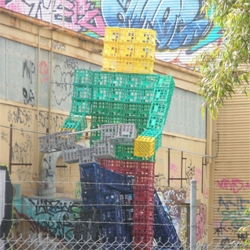 Crate man has been spotted at several places in Australia. These series of Installations definitely adds a spin to graffiti.