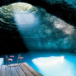 Homestead resort in Utah offers warm water scuba diving into an amazing natural crater. The hole at the top of the dome lets in sunlight and fresh air.