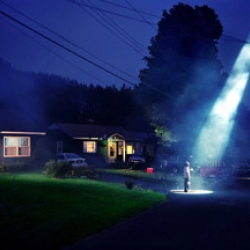 Gregory Crewdson: Similiar in style to diCorcia, his photographs are on a much larger scale, production wise. Epic levels of drama are reached with film quality lighting and ultra obsessive compulsive scene creation.