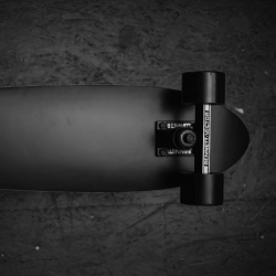 A recycled skateboard, to honor all the good memories stored within the wood. The All Black Cruiser Deck by the F and F and F.