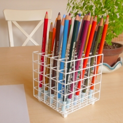 Cube Pen Stand for the Meticulous  is a 3D printed cubic structure, made in nylon plastic, that is designed to hold 25 pens or pencils upright in a neat and orderly arrangement.