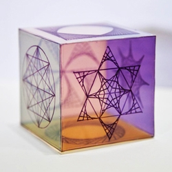 Using a Rubik's Cube as a model, this colorful, transparent box adds math art to the mix with drawings made of only straight lines and circles.