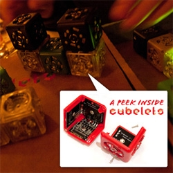 Cubelets! The modular magnetic robotic construction kit up close... hands on with them over beer... and taking a screwdriver to them to peek inside!