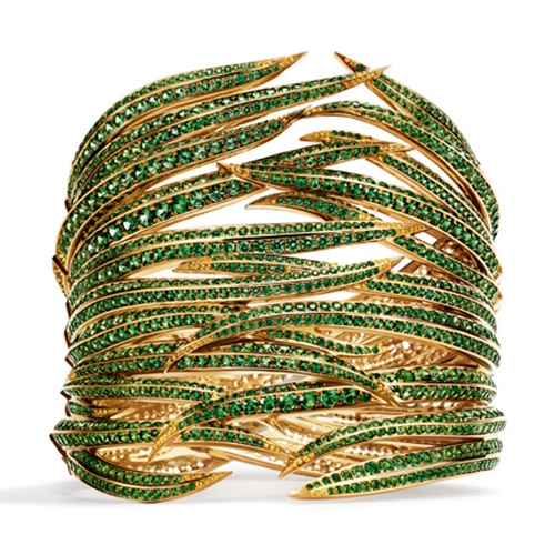 Tiffany & Co lush green plant inspired cuff in 18k yellow gold with round tsavorites and round yellow sapphires, from the Tiffany 2017 Blue Book Collection, the Art of the Wid.
