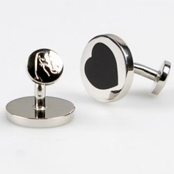 Not so into gifting traditional red hearts and such for Vday - shopping for a guy is hard... but these subtle Paul Smith cufflinks are a pretty nice solution.