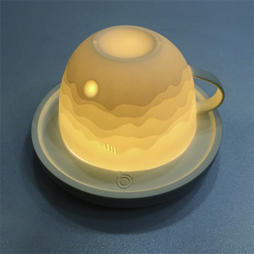 Lightning Cup by Jin-woog Koo of the Nothing Design Group. Variations in thickness create beautiful landscapes when lit from within. It can be used as both a cup and a light.