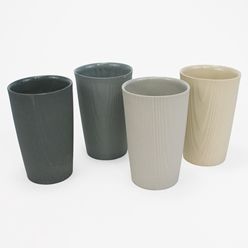 Edge Wood Made Wood Grain Cup - a stunning porcelain cup with unglazed wood grain textured exterior and glossy glazed interior. It feels incredible in person!
