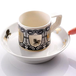 Mesmerizing round-round-land spinning cup and saucer by Biaugust.