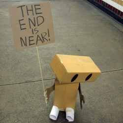 """Philadelphia-based artist Larry West posted a bunch of photos of this adorable robot with a sign that says """"The End Is Near!"""""""