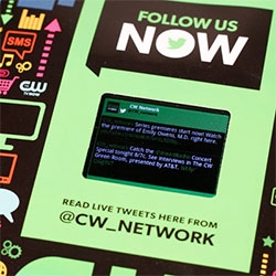 """CW is promoting its fall lineup with an LCD screen with live tweets in Entertainment Weekly, using """"a custom-built, smartphone-like Android device with an LED screen and 3G connectivity; it was manufactured in China."""""""