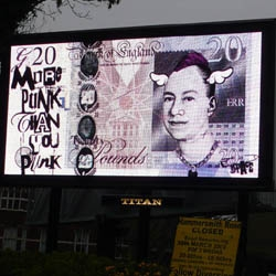Street artist D*Face took his protest of the G20 Summit digitally with a series of billboards. Question is are they paid for or hacked?